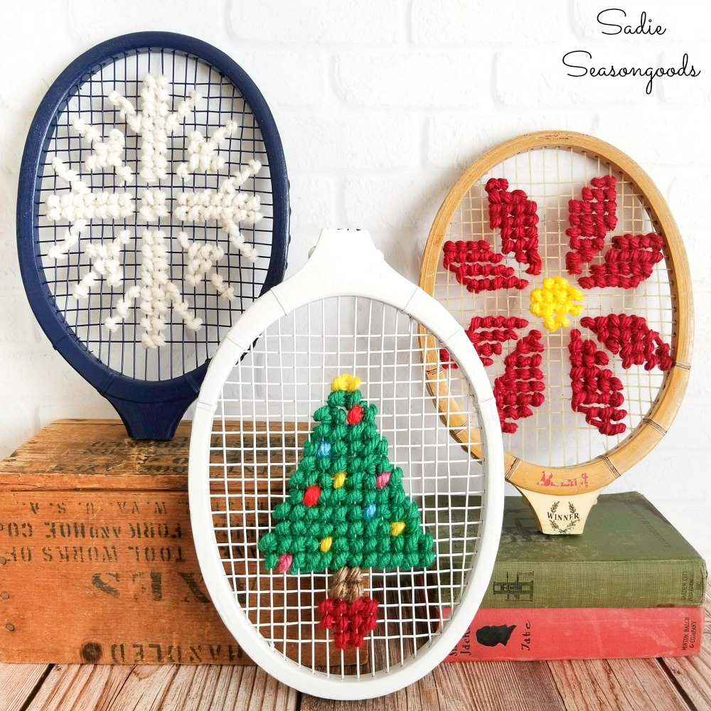 Christmas cross stitch on the heads of vintage tennis rackets