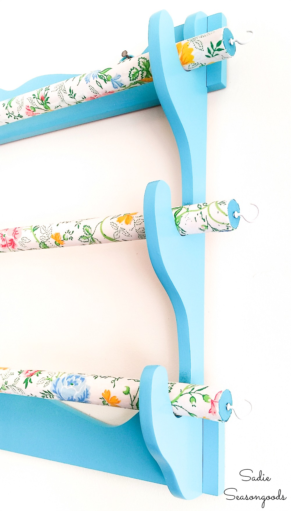 Cup hooks on the ends of a fabric organizer for fabric scraps