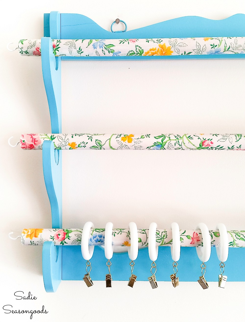 Hanging gun rack as a fabric organizer for sewing room storage ideas