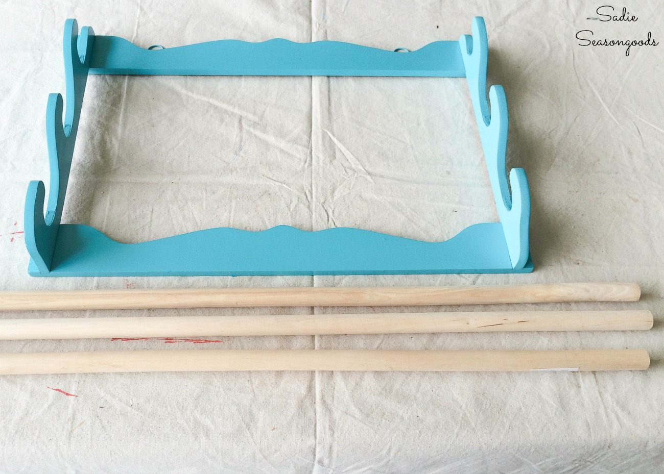 Wooden dowels to go in a hanging gun rack for scrap fabric