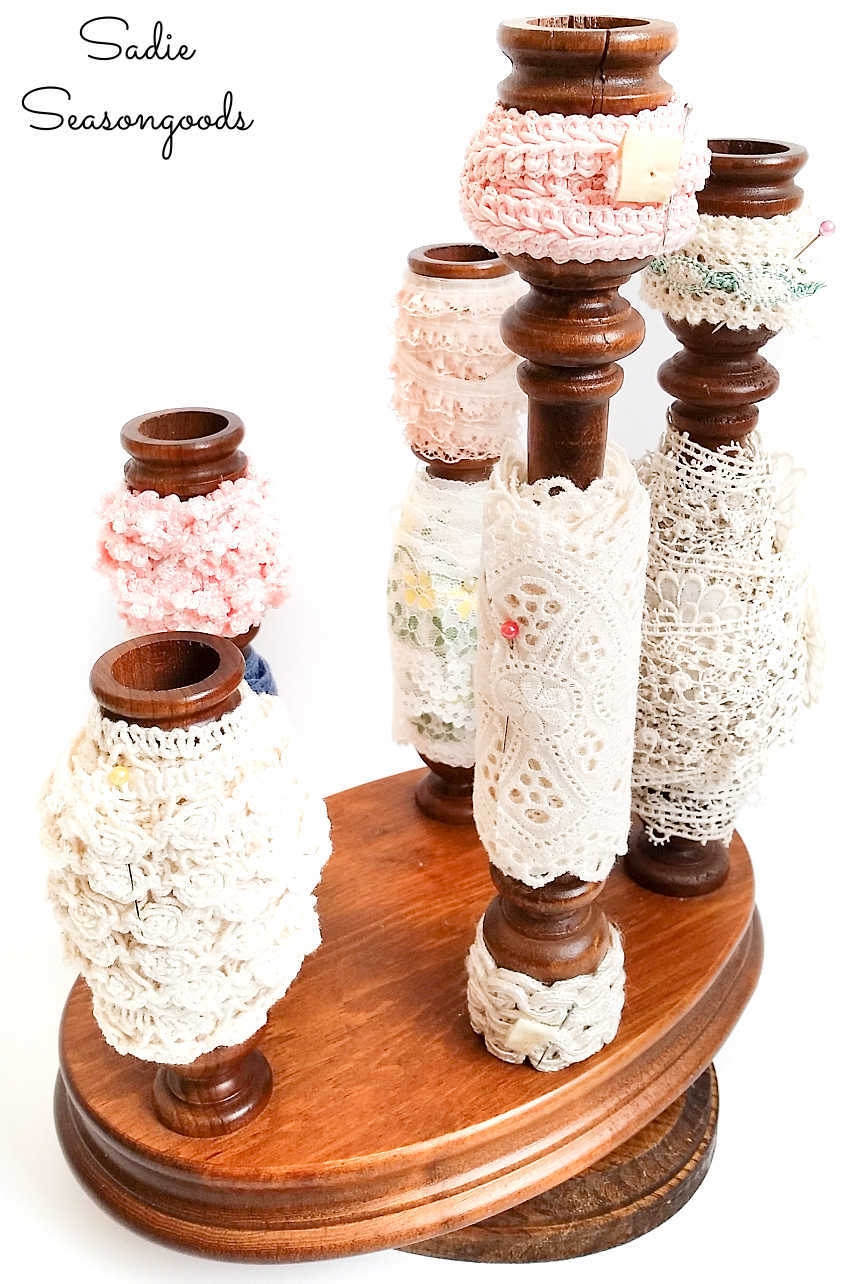 ribbon organizer on a wooden candle stand