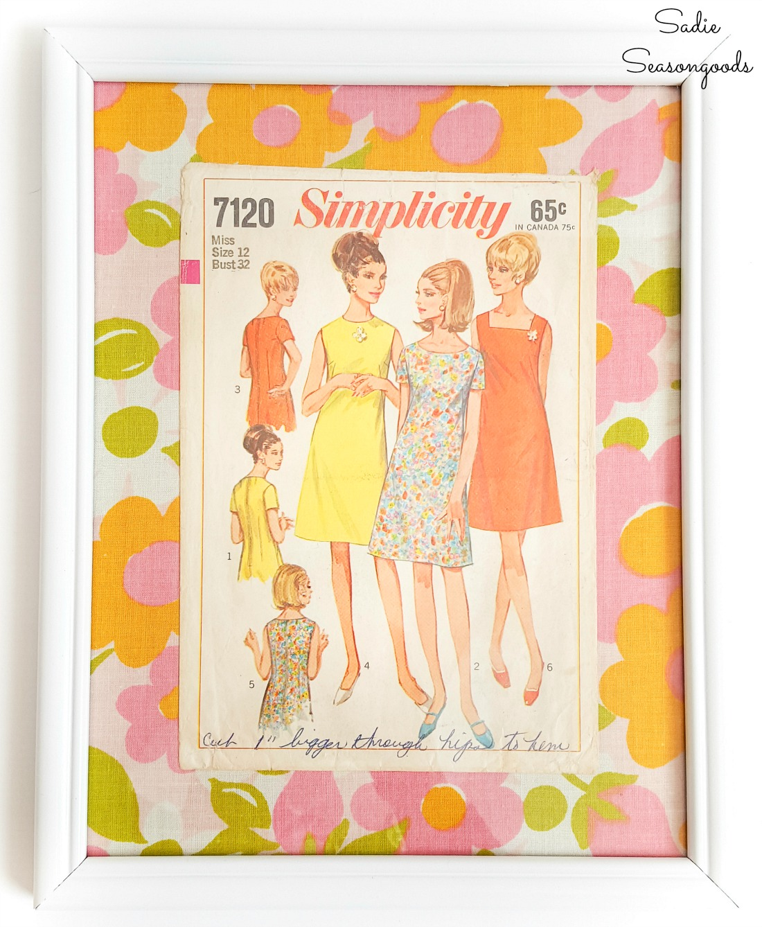 Fashion wall art with vintage sheets and Simplicity sewing patterns