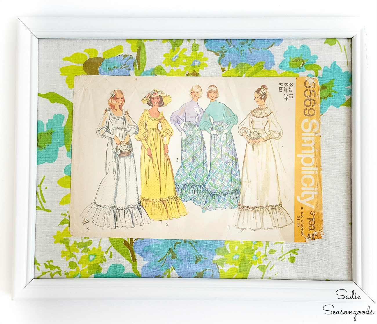Sewing room decor by framing the vintage dress patterns
