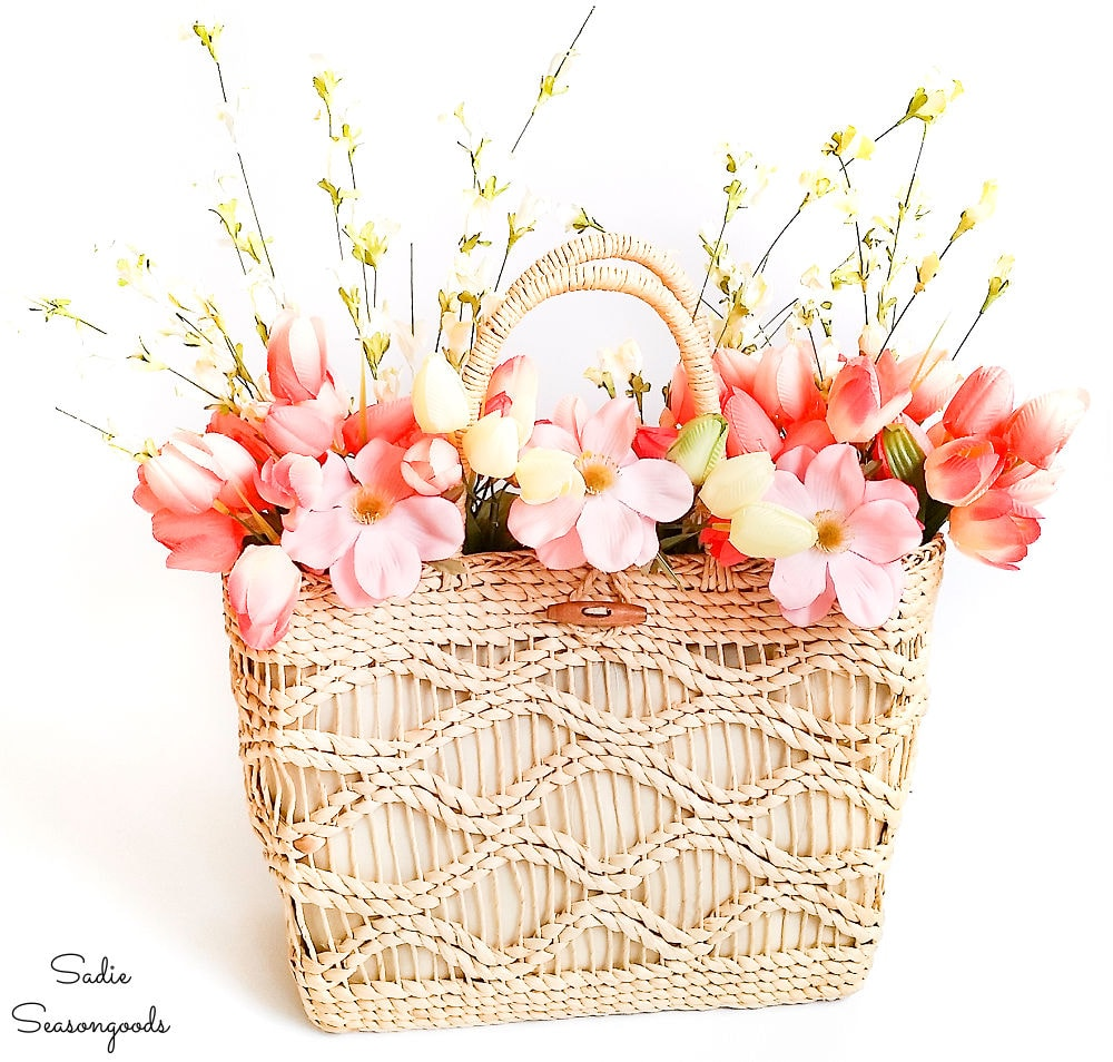 Straw tote as spring floral wreath