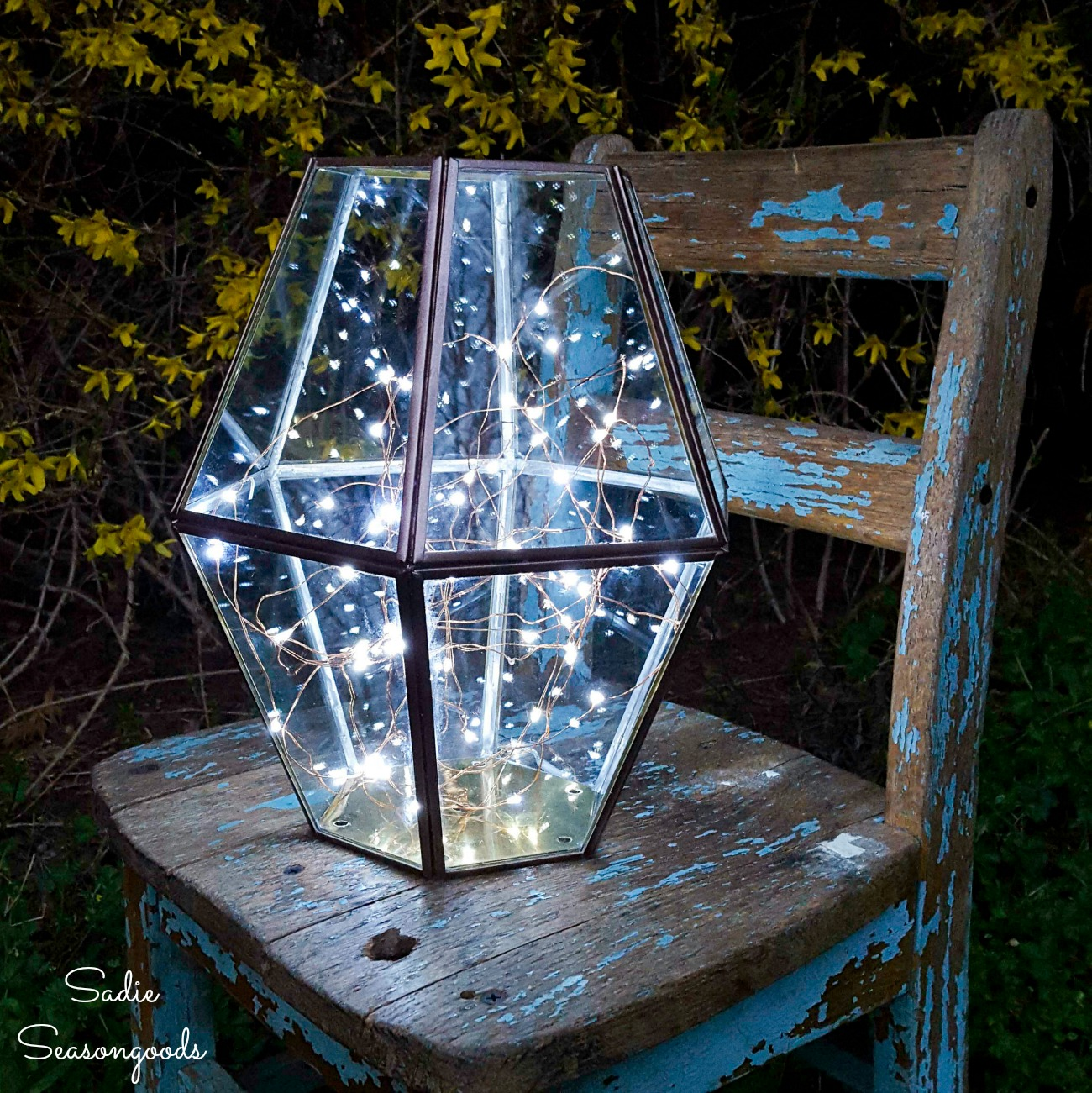Firefly lantern with a brass light as upcycled lighting