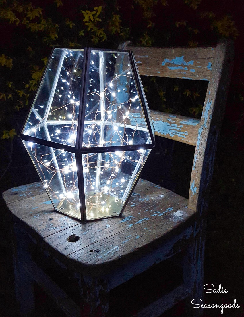 Firefly lights in upcycled lighting as a porch lantern