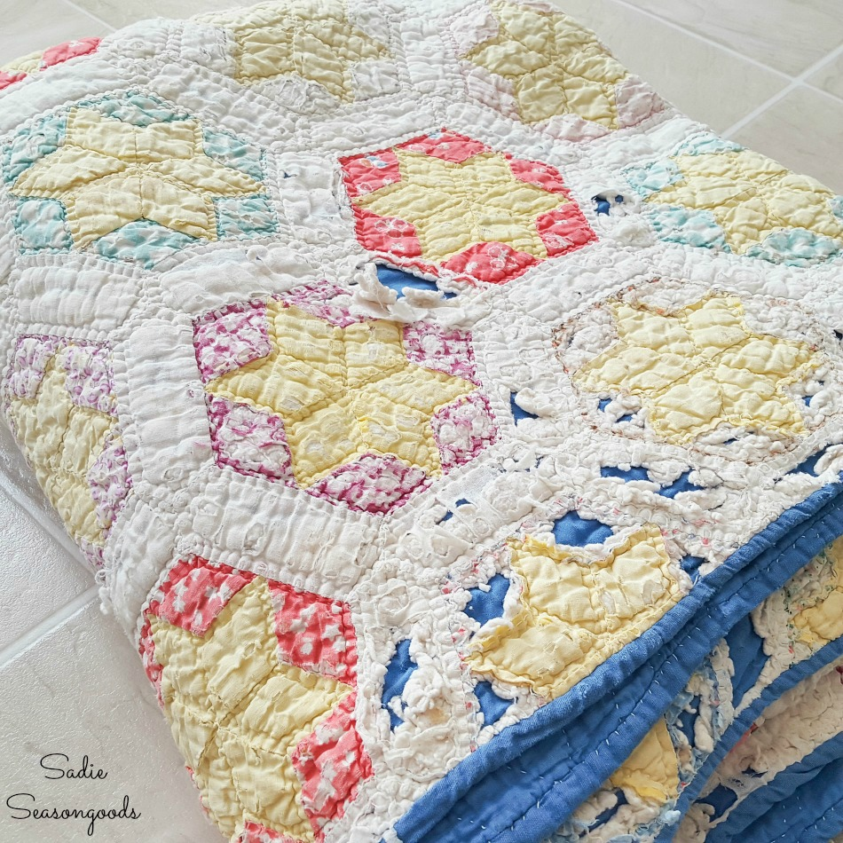 Vintage quilt that is falling apart for upcycling crafts