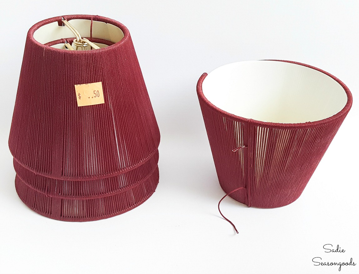 Upcycling the small lampshades into the wire hanging baskets for herb pots