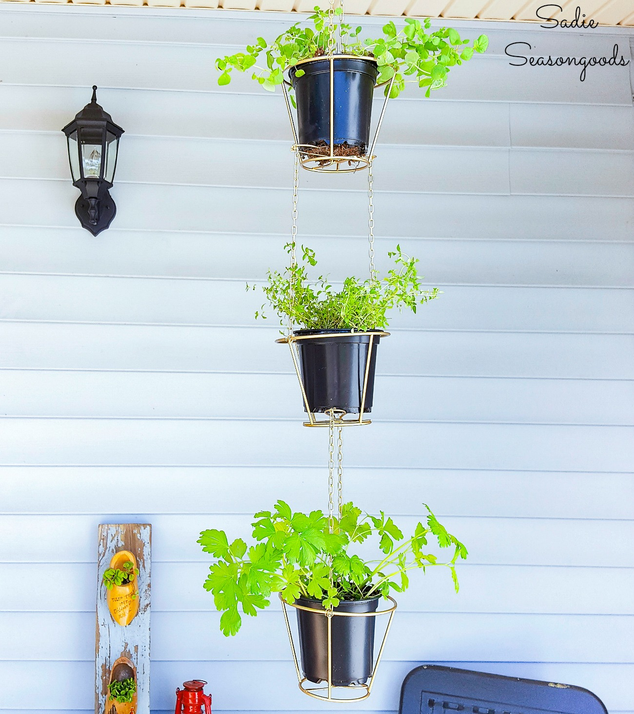 Wire hanging baskets for a vertical herb planter by upcycling the lampshade frames