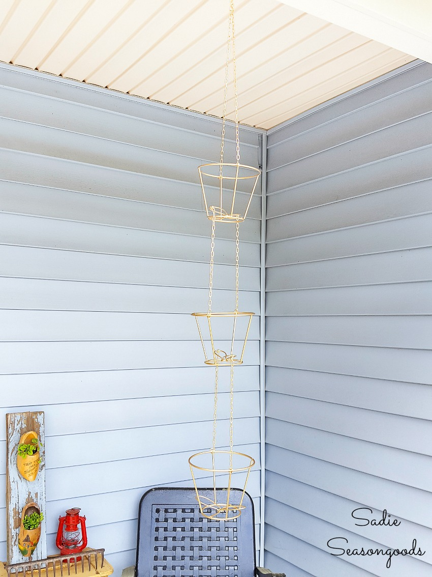 Wire hanging baskets for herb plants by upcycling the lampshade frames