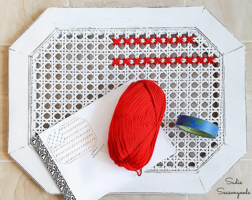 yarn cross stitch on a cane table