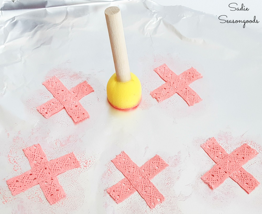 Game pieces for a tic tac toe board with a wooden cake stand