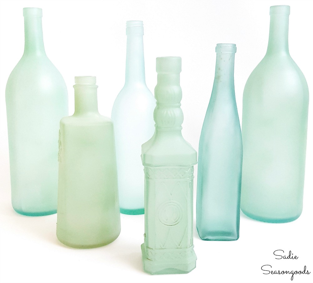 Sea glass bottles as wine bottle crafts for beach theme decor
