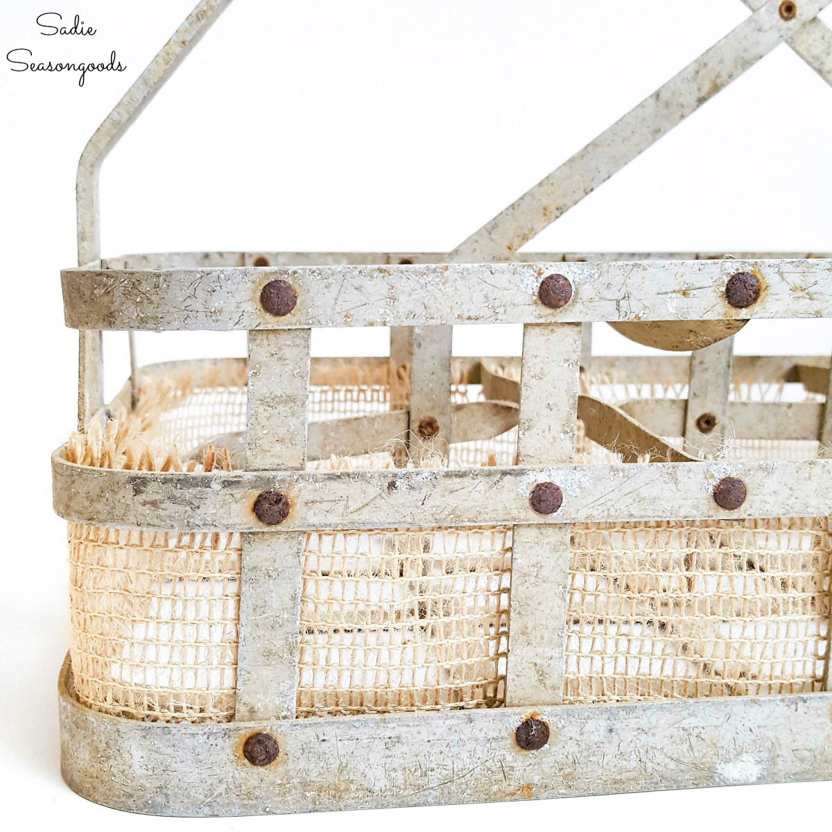 Vintage milk bottle carrier with burlap ribbon