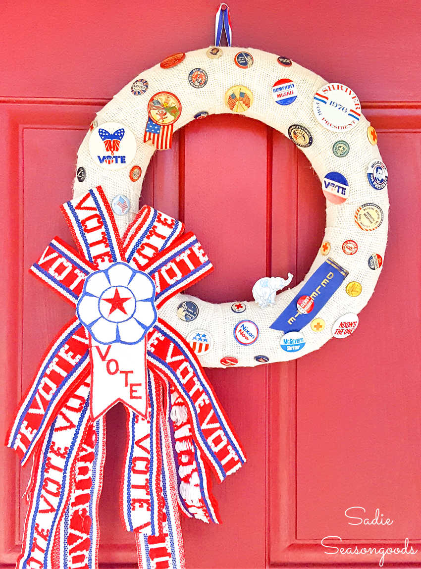 vintage campaign buttons on a red white and blue wreath