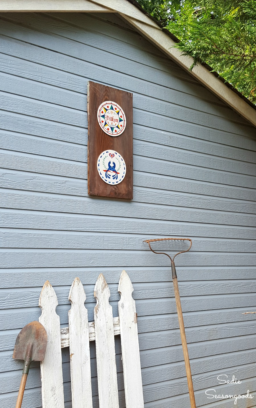 Hex signs displayed on a tool shed to look like barn decor or outdoor wall decor by Sadie Seasongoods