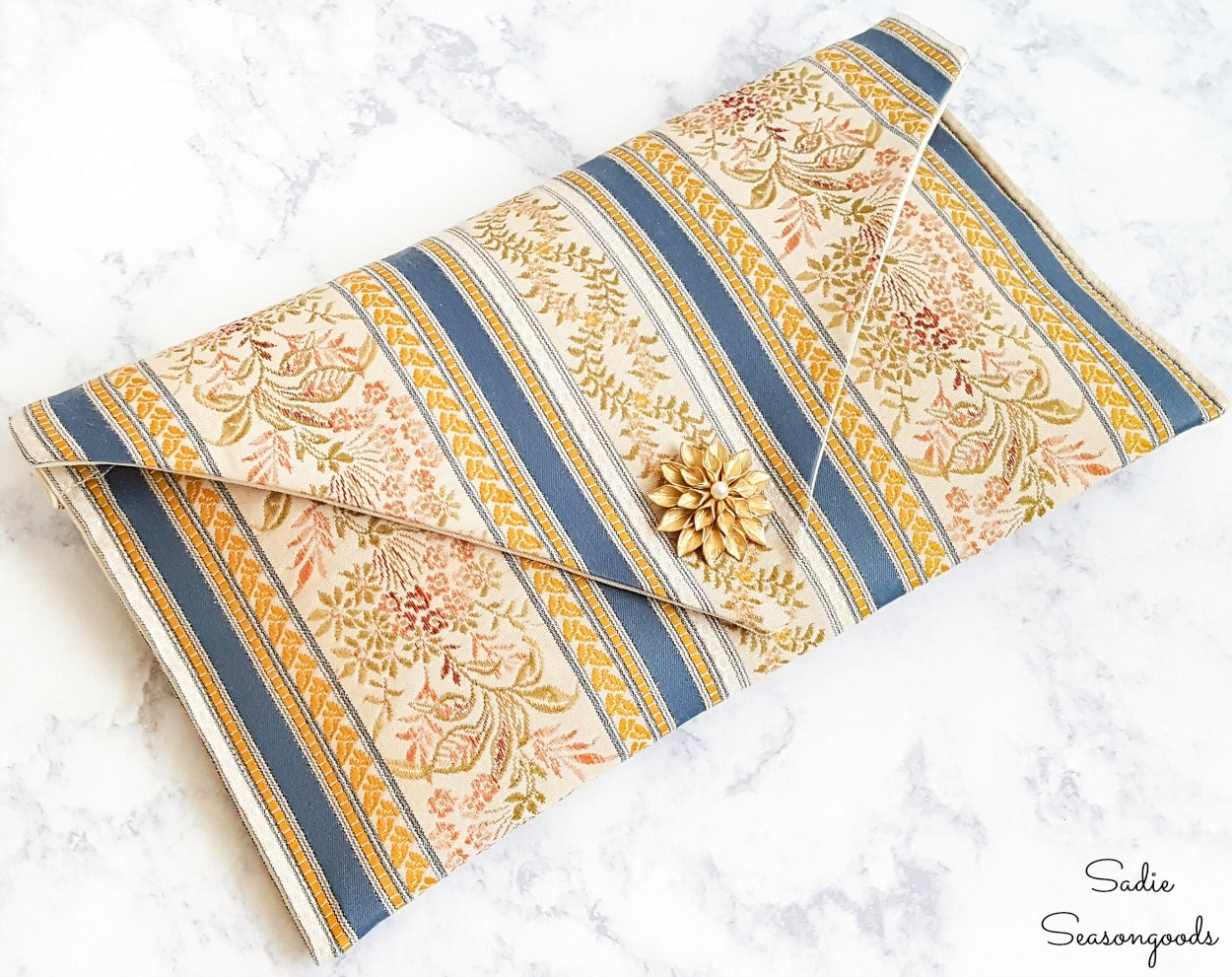 Decorating a clutch with a brooch or pin