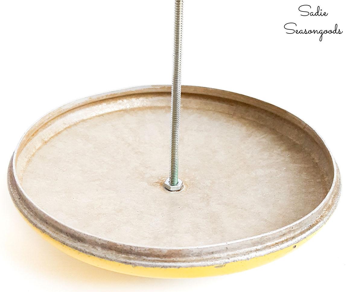 Platform bird feeder from a soup pot lid