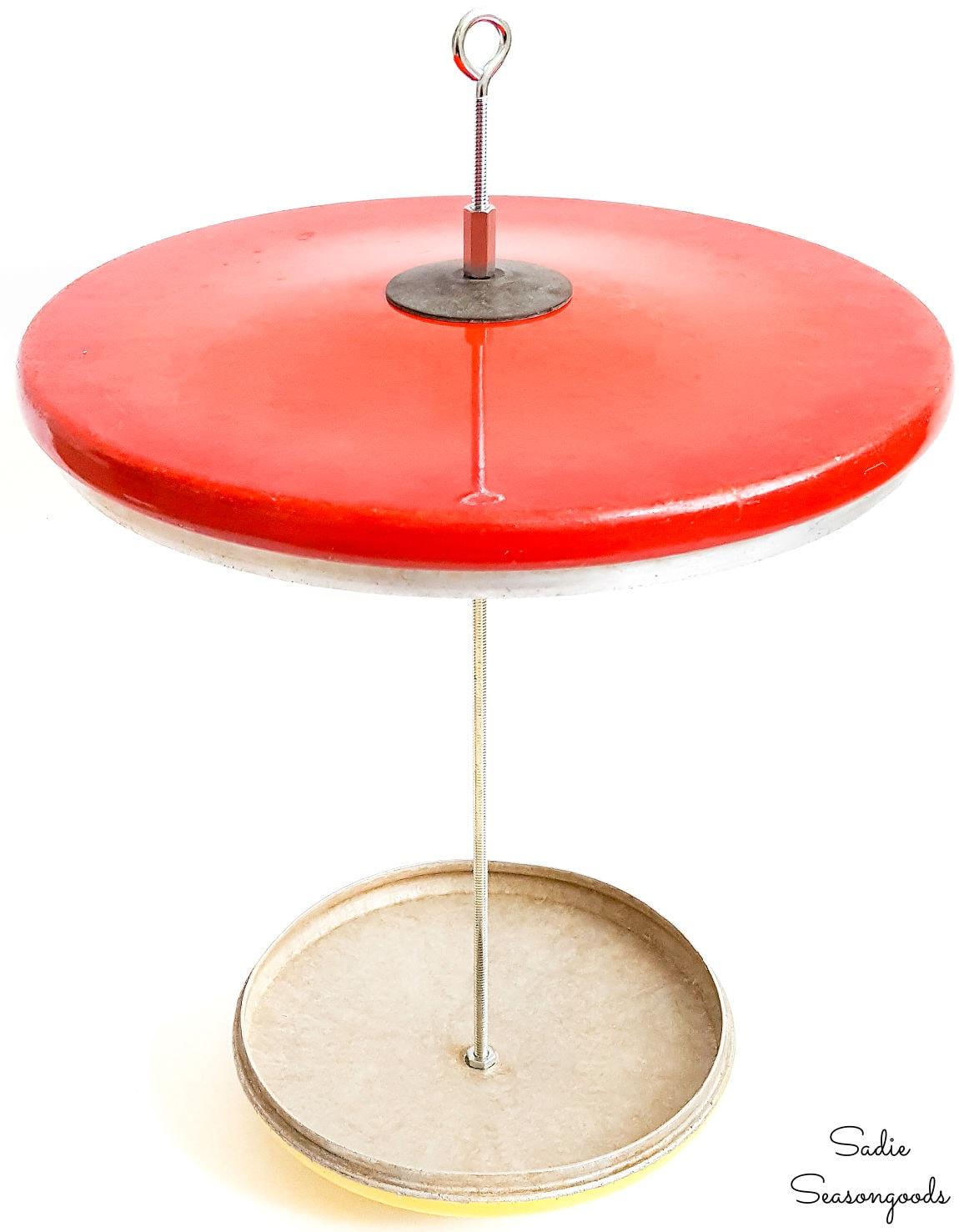 Repurpose pot lids as a platform bird feeder