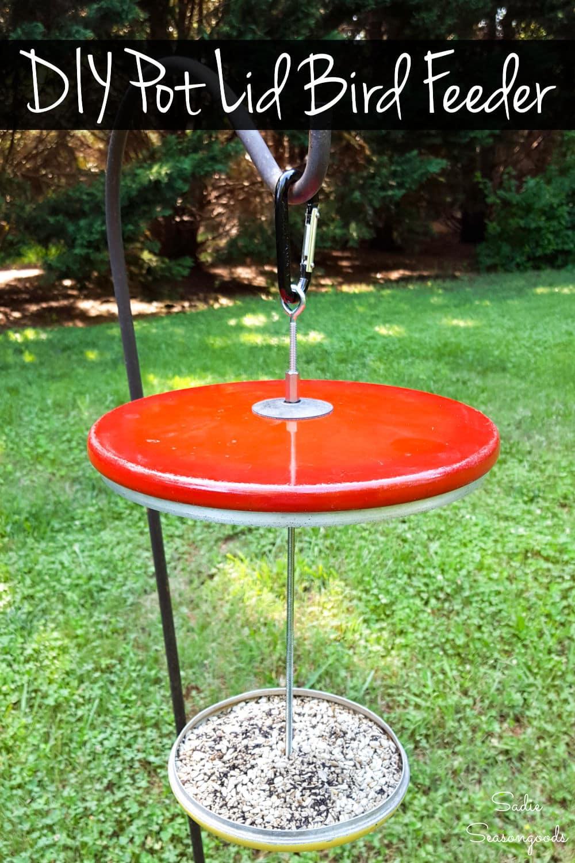 Repurposed pot lids as a DIY bird feeder