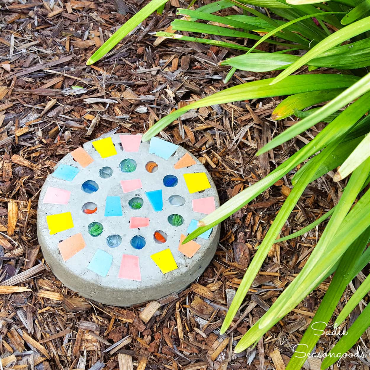 DIY mosaic stepping stone with key hider