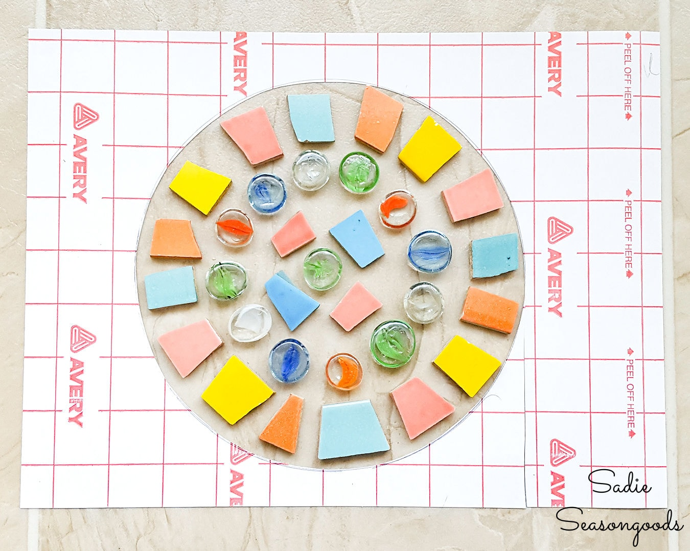 Making a mosaic stepping stone with glass gems