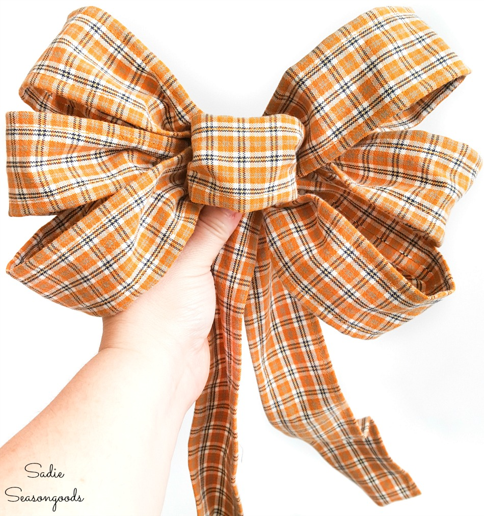 Making a bow with plaid ribbon