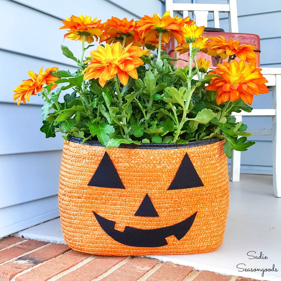 Halloween porch decorations from a straw tote as a jack o lantern