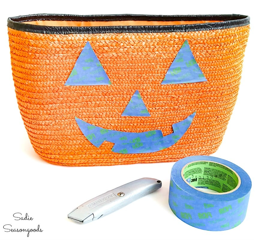 Making a jack o lantern face on a straw tote