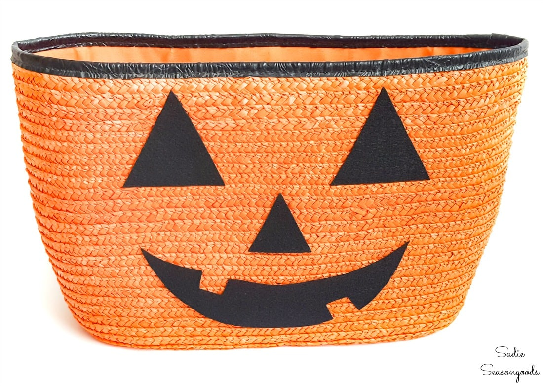 Straw tote as a jack o lantern planter
