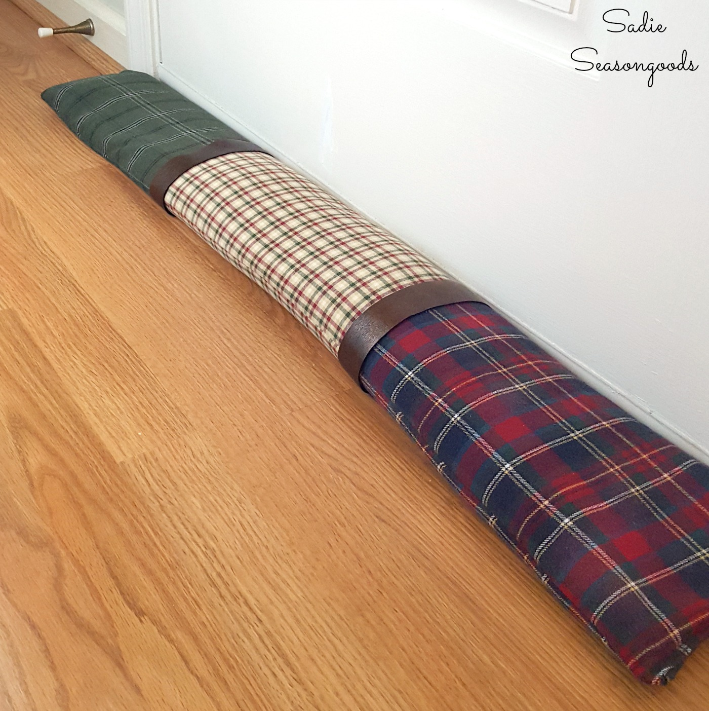 Door draft guard or draft stopper made from repurposed clothing and flannel shirts as cabin decor or rustic decor