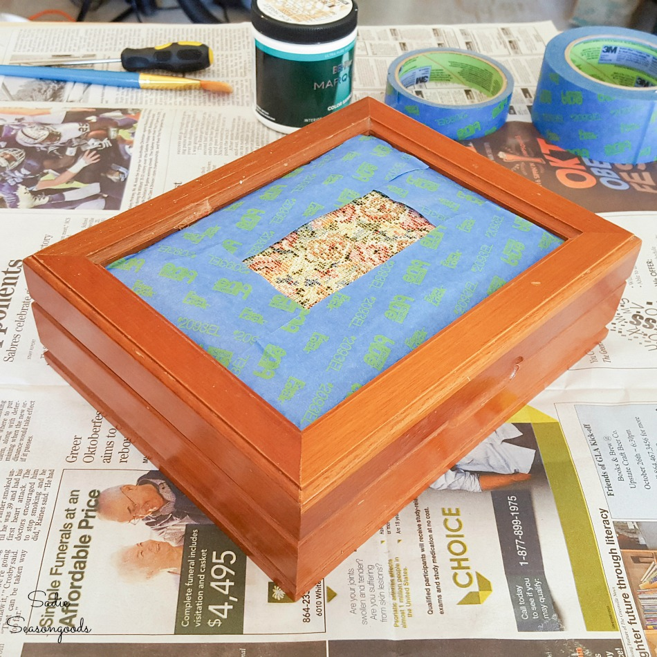 Protecting a tapestry cushion lid with painter's tape