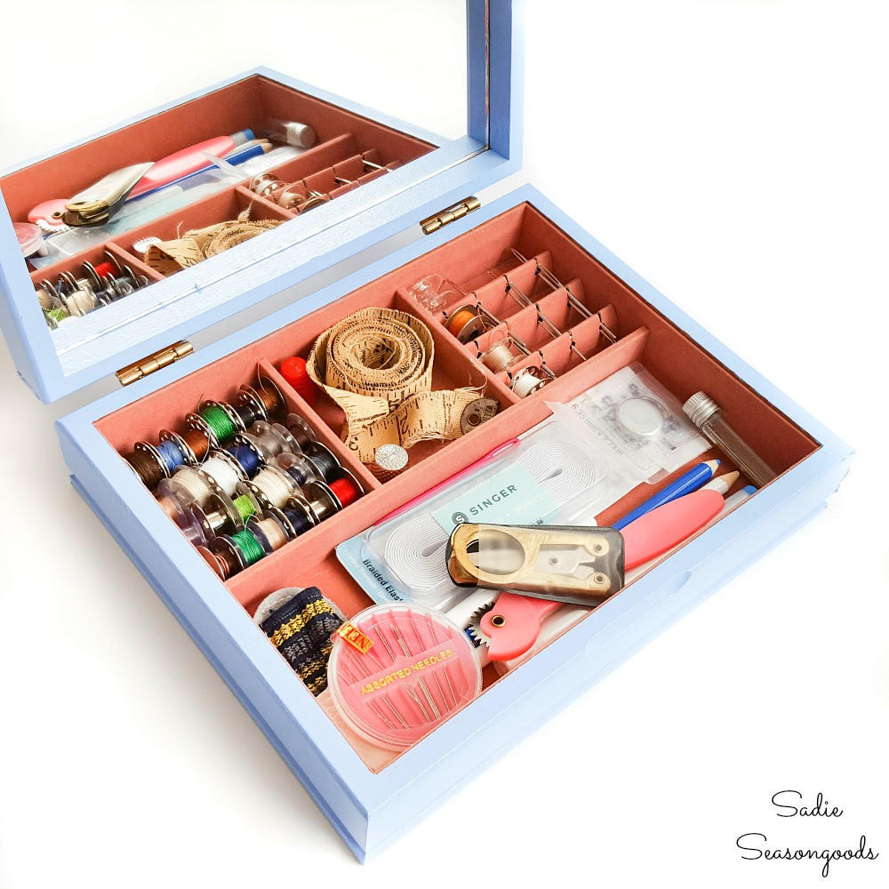 Sewing supplies in a vintage jewelry box for storage