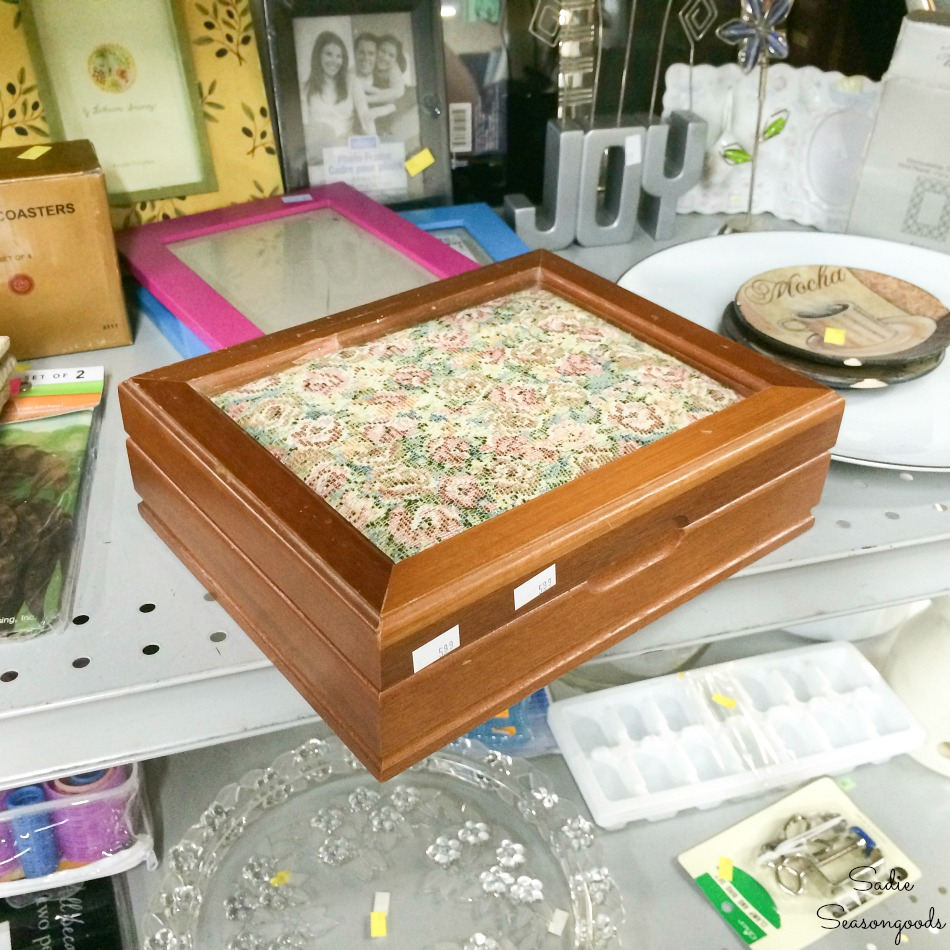 Vintage jewelry box with a tapestry cushion lid