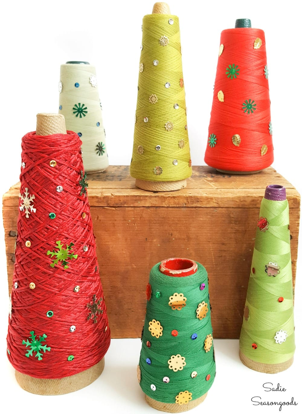 Decorating the tabletop Christmas trees with vintage sequins