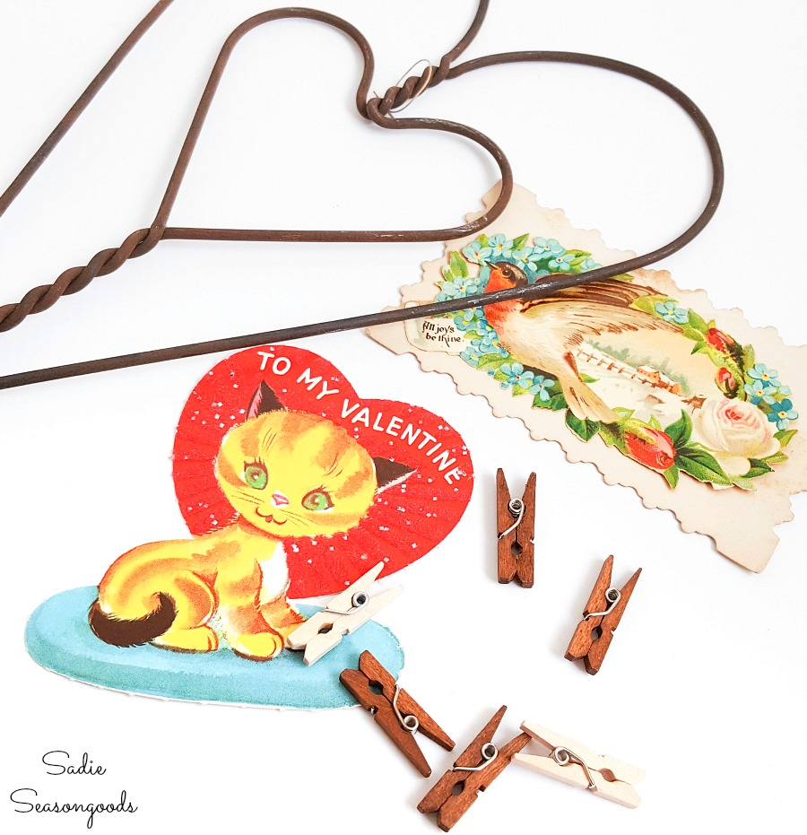 Clipping on the little valentines or vintage valentine to a rug beater with mini clothespins
