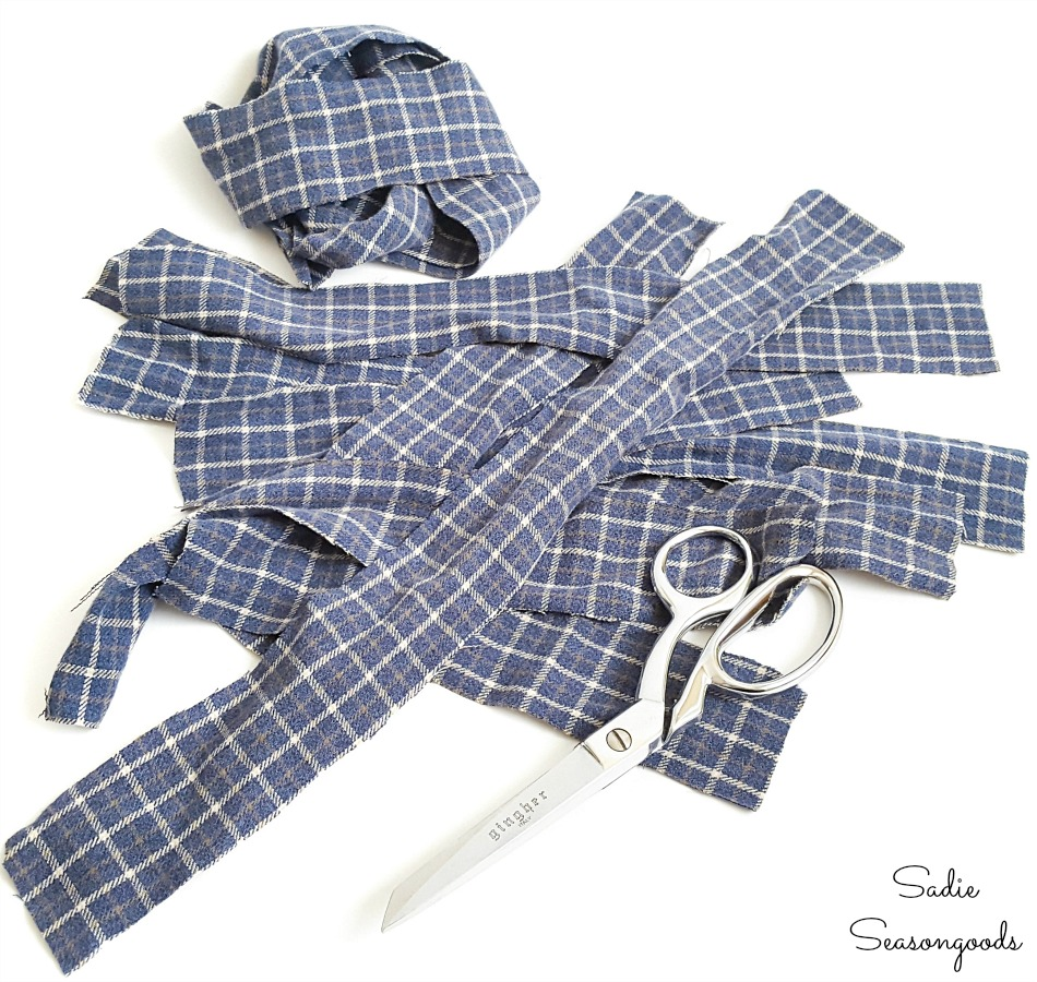 Cutting a flannel shirt into strips to make ribbon