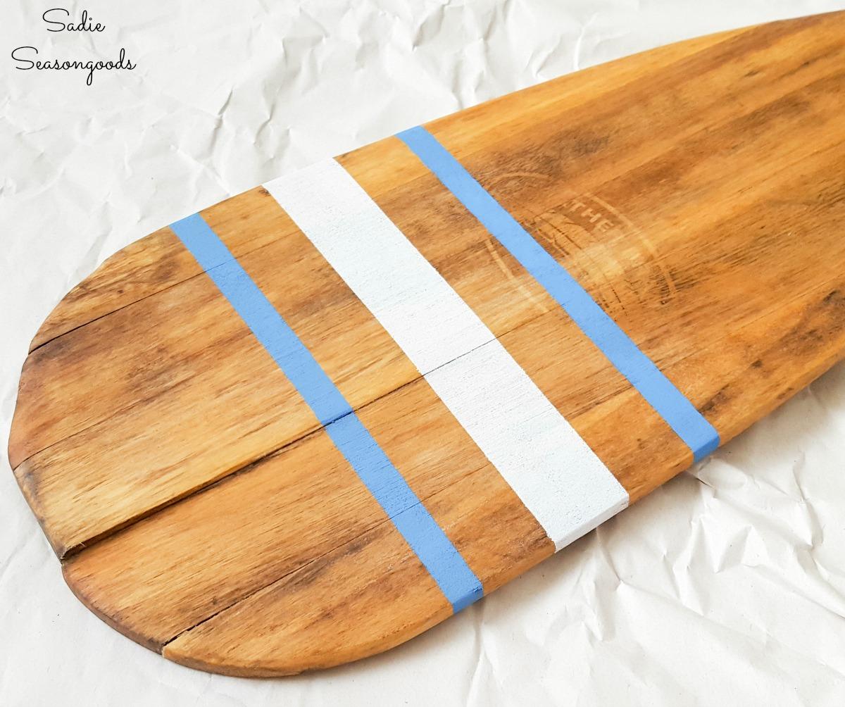 Nautical stripes on wooden oar decor