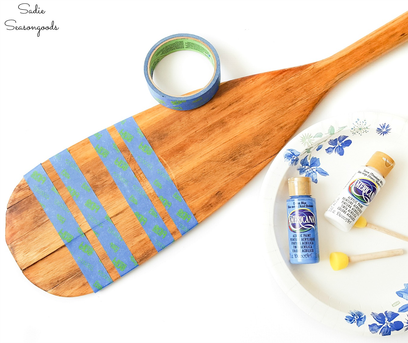 Painting stripes on a row boat oar