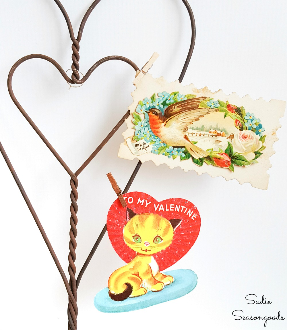 Vintage valentine decorations with little valentines that are clipped to a rug beater