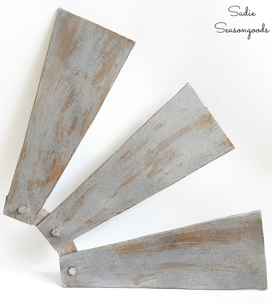 Windmill decor or industrial wall decor by repurposing the ceiling fan blades with galvanized paint