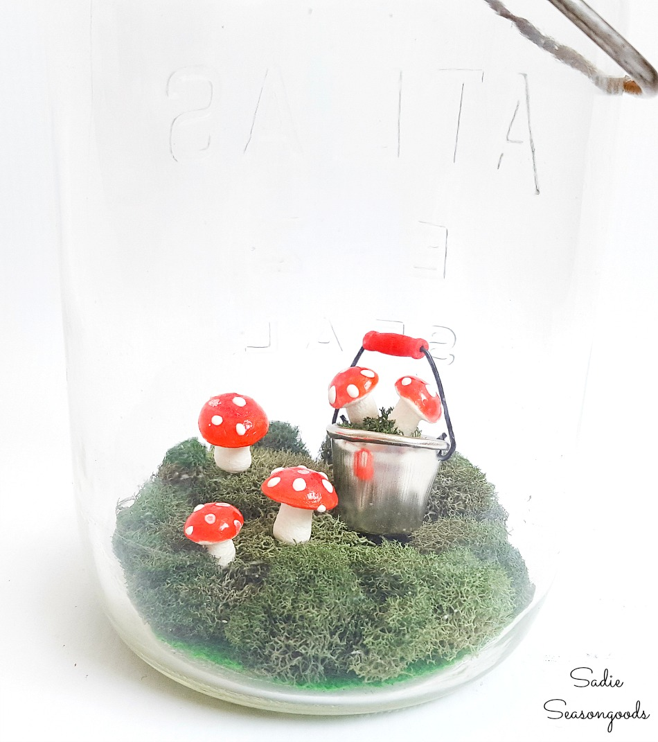 Decorating ideas for Spring with fairy garden accessories and vintage glass jars