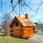 Making a DIY Birdhouse from a Vintage Bank that Looks Like a Log Cabin