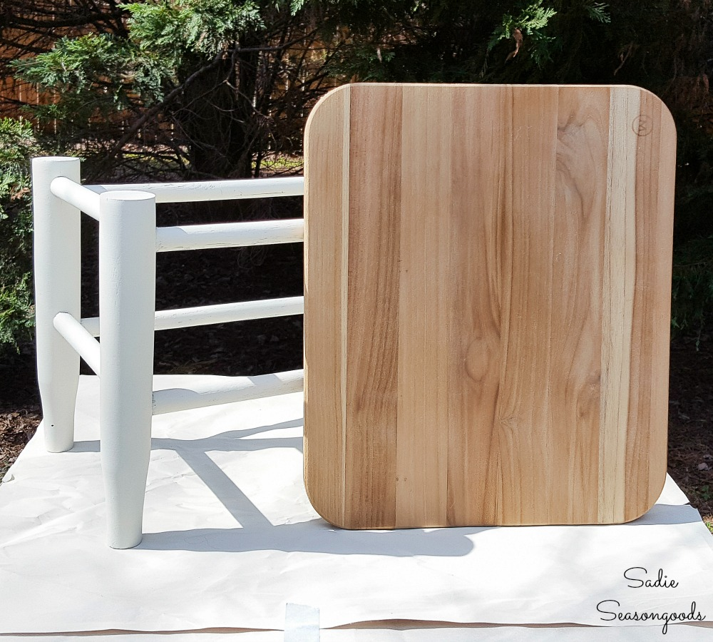 Replacing the rush seat of a vintage footstool with a wooden cutting board