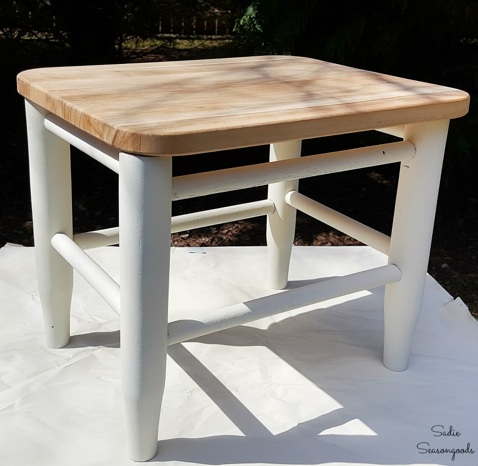Transforming a wooden footstool into farmhouse furniture with a cutting board