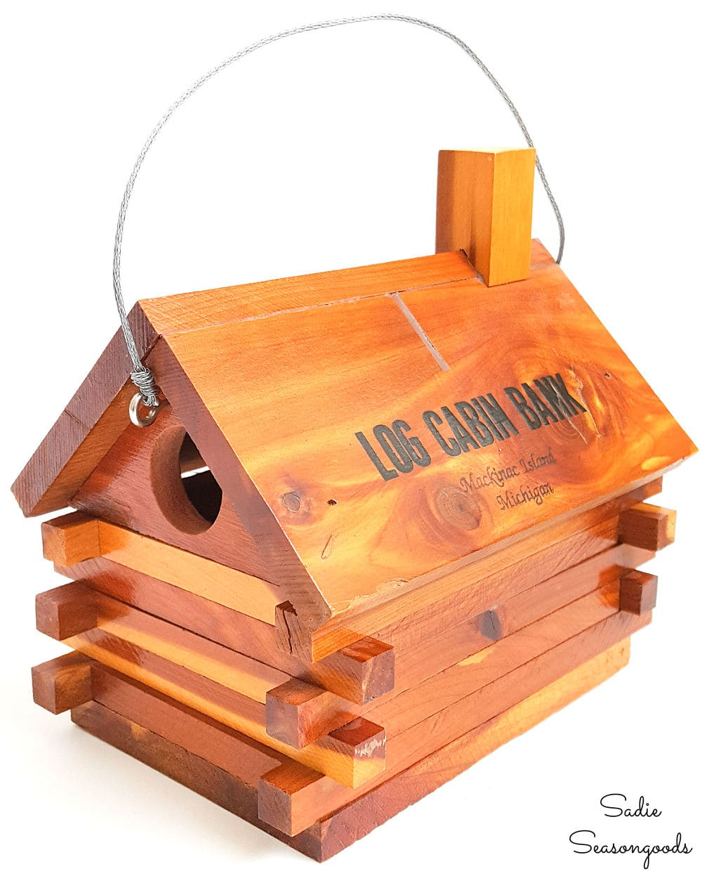 Cabin birdhouse from a vintage coin bank