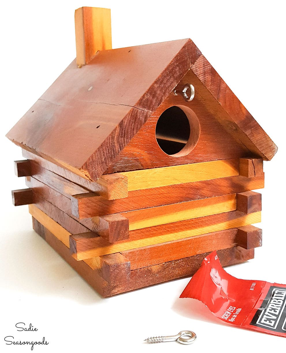 Screw eyes for hanging a log cabin bird house
