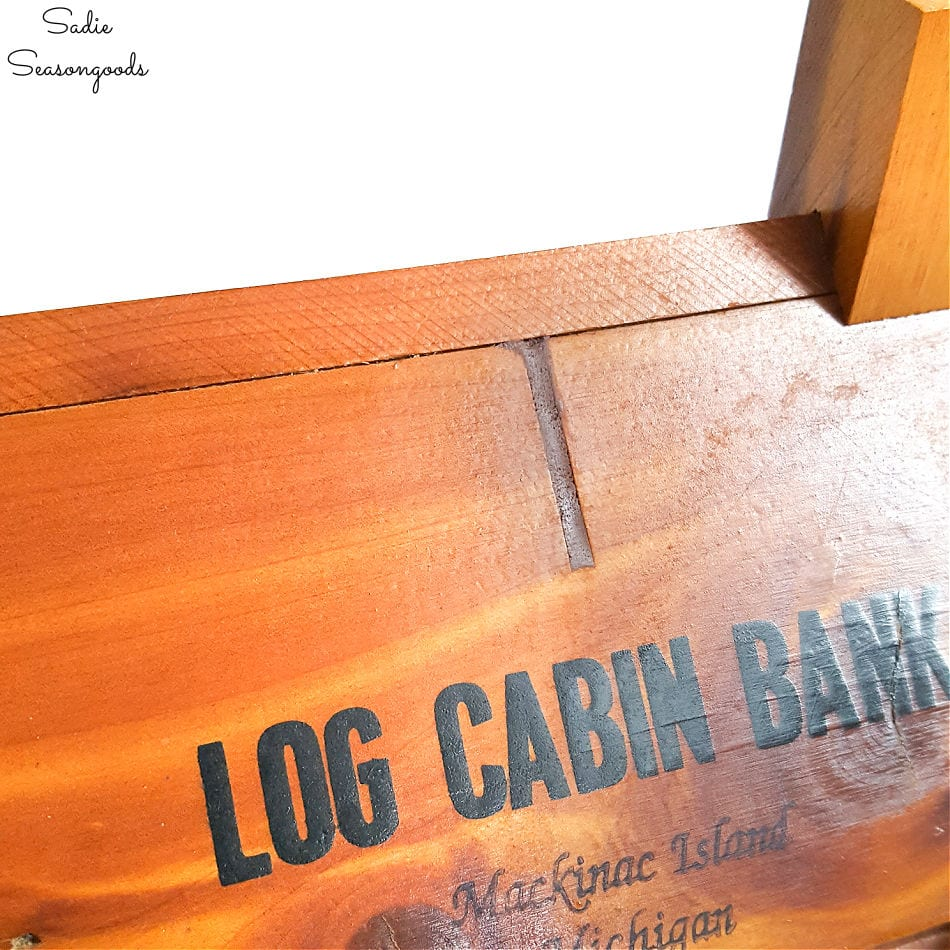 Upcycling a vintage coin bank as a log cabin birdhouse