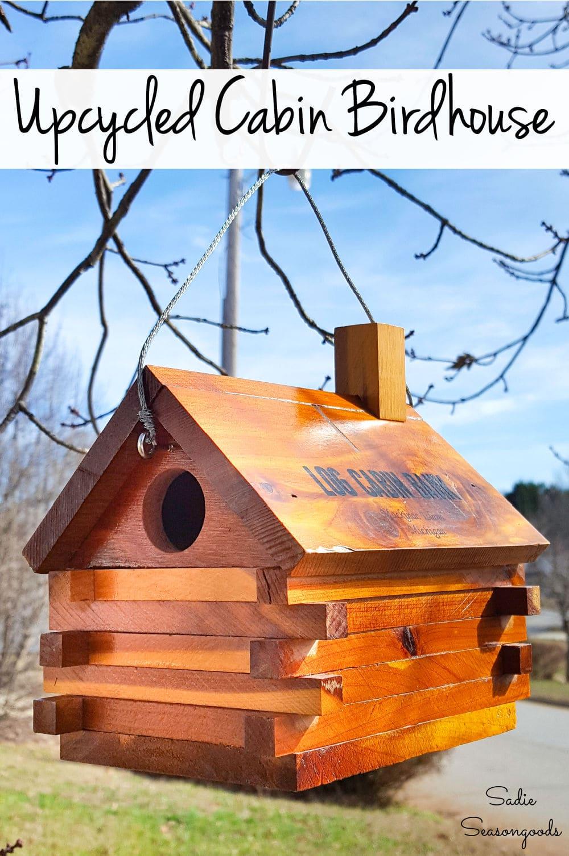 Vintage coin bank as a log cabin bird house