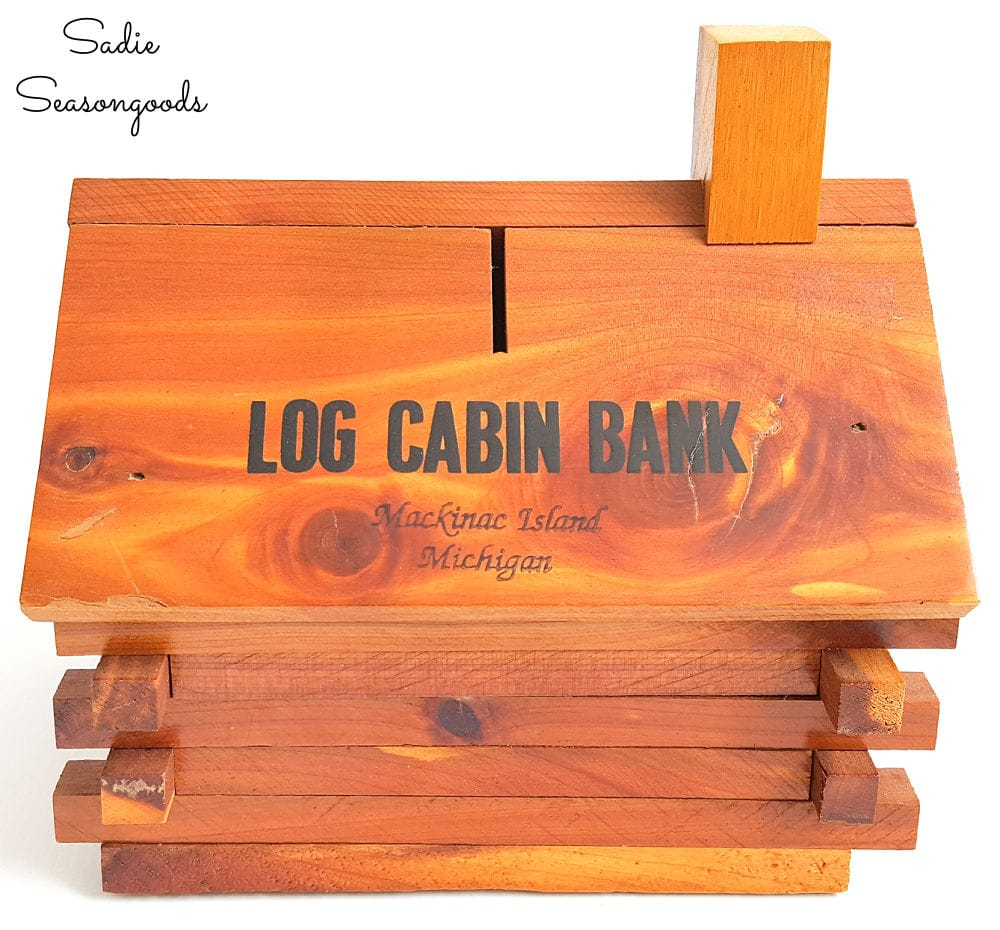 Vintage coin bank in the shape of a cabin